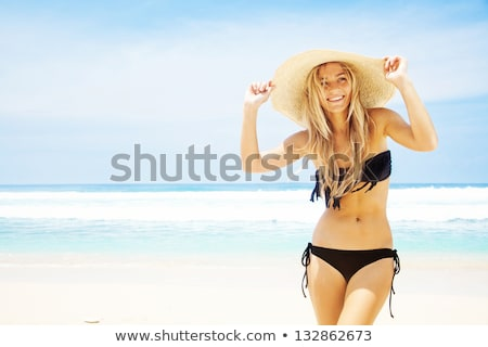 happy young woman in bikini swimsuit and sun hat stock photo © dolgachov