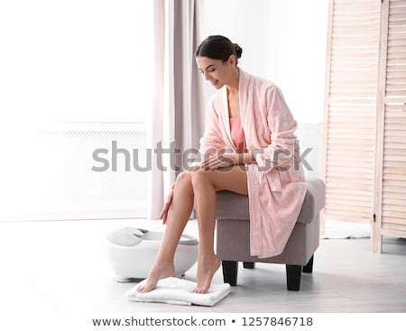 beautiful young woman in towel sitting on the floor stock photo © deandrobot