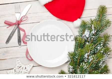 Mikulás kalap ezüst étkészlet karácsonyfa felülnézet fehér Stock fotó © karandaev