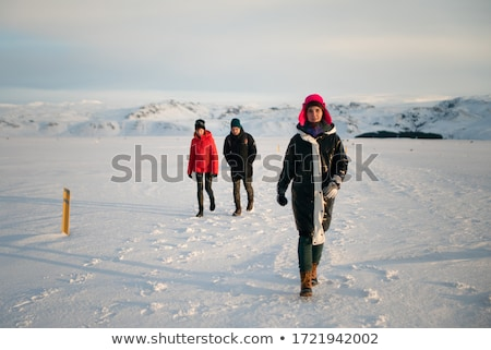 man goes through the snowy field Stock photo © Paha_L