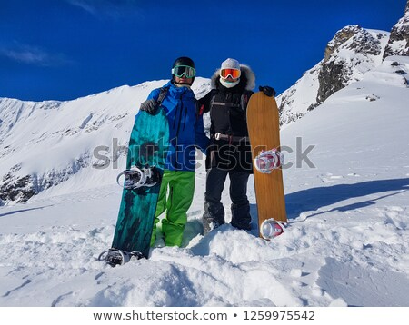 Happy young couple posing with their snowboards Stock photo © dash