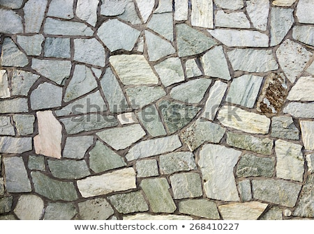 section of flagstone wall with varying shapes and lines stock photo © meinzahn