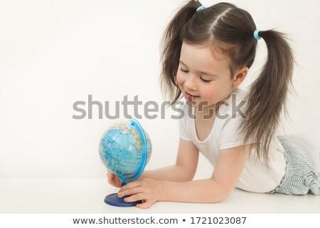 Kettő kislányok felfedez földgömb ül padló Stock fotó © stockyimages