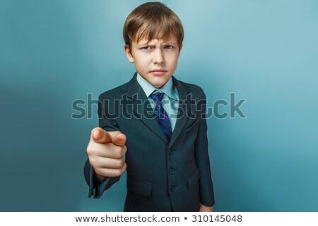 Jóképű fickó előadás kezek tizenkettő ujjak Stock fotó © zurijeta