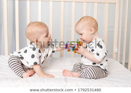 two sisters twins sleeping in bedroom together stock photo © deandrobot