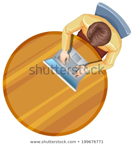 A topview of a man using his laptop above the table Stock photo © bluering