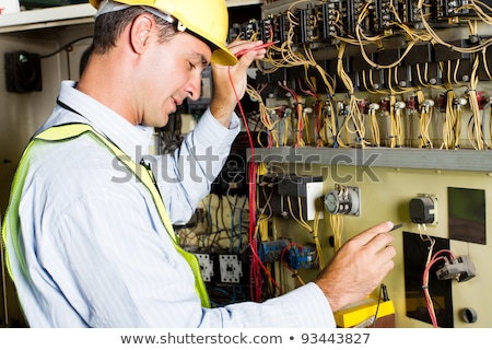 Technician testing a control panel  Stock photo © mady70