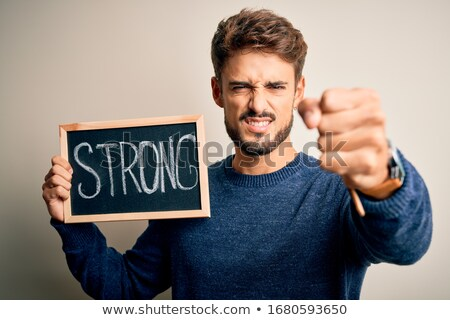 Furious young man yelling over background of chalkboard Stock photo © deandrobot