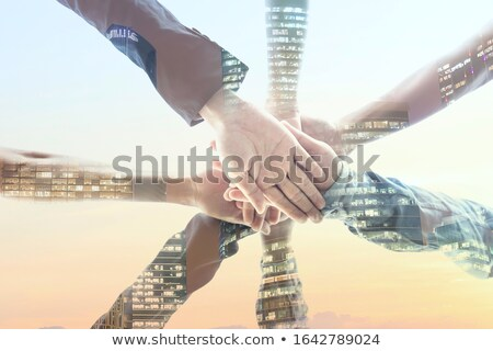 Image of young partners putting hands together for strenght and  Stock photo © zurijeta