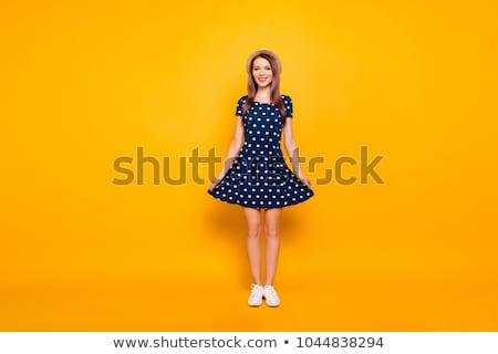 Boldog vonzó nő ruha sportcipők pózol vonzó Stock fotó © deandrobot
