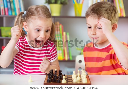Two preschoolers play at the table stock photo © superelaks