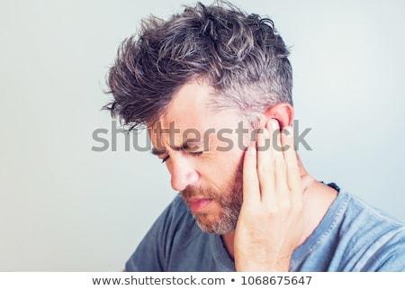 уха более молодым человеком , держась за руки голову человека Сток-фото © kalozzolak