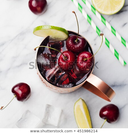 Сток-фото: Cold Cherry Moscow Mules Cocktail With Ginger Beer Vodka Lime Marble Background Top View