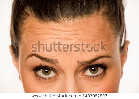 Gyönyörű fiatal nő mutat homlok szépség emberek Stock fotó © dolgachov