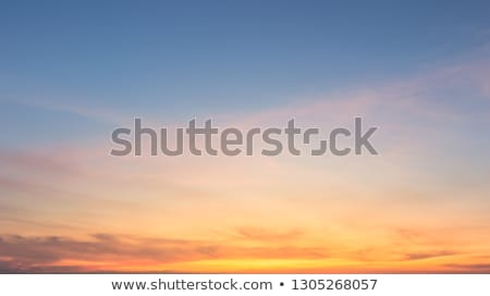 Fluffy orange clouds in winter sunset Stock photo © stevanovicigor
