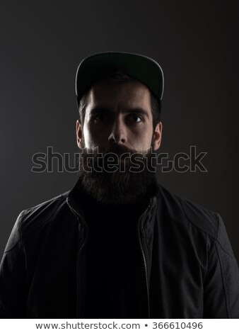 Portré bámul férfi visel baseballsapka kecskeszakáll Stock fotó © ozgur