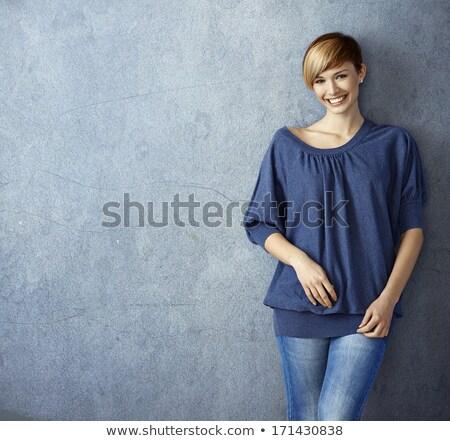 Portré fiatal vonzó nő farmernadrág rövidnadrág izolált Stock fotó © deandrobot