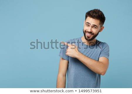 portré · mosolyog · fiatalember · kockás · póló · mutat - stock fotó © deandrobot