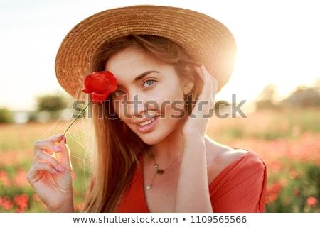Donna fiore papavero campo estate seduta Foto d'archivio © artfotodima