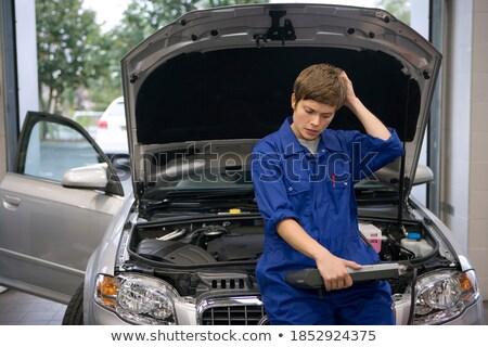 Young caucasian mechanic scratching her head. Stock photo © RAStudio