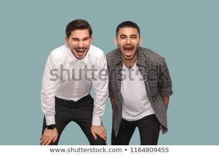 Jonge kaukasisch zakenman lachend uit luid Stockfoto © RAStudio