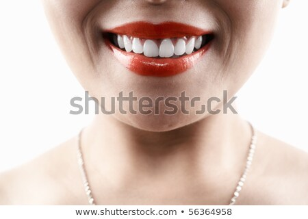 Stock photo: Grinning female mouth with red lips