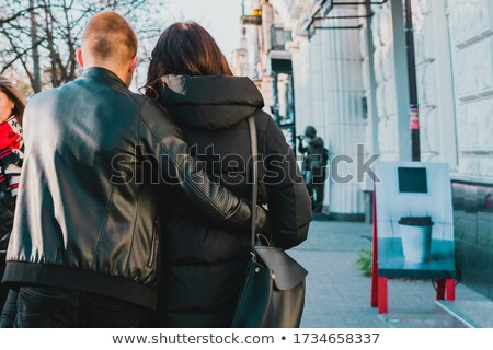 Guy and girl in black jackets on a city street Stock photo © tekso