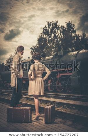 Jovem atraente moda senhora estação de trem espera Foto stock © iordani