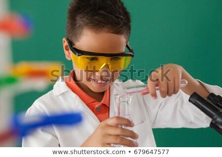 Estudante verde atento criança criança lab Foto stock © wavebreak_media