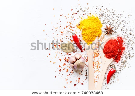 Wooden spoons with various pepper spice on white background stock photo © ivo_13