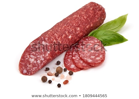 Stock photo: slices of dry cured salami with spices