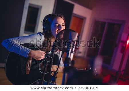 Fiatal nő énekes fejhallgató portré mikrofon zene Stock fotó © AndreyPopov