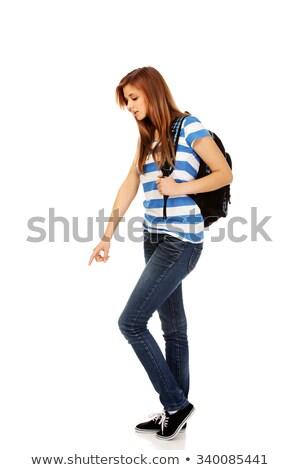Femme permanent pointant doigt vers le bas espace de copie Photo stock © deandrobot