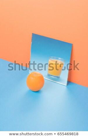 Frutas espejo azul mesa aislado naranja Foto stock © deandrobot