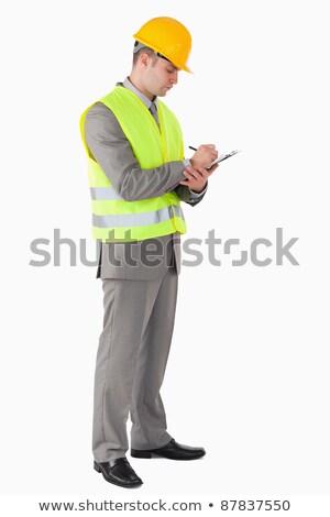 Young caucasian building inspector with clipboard. Stock photo © RAStudio