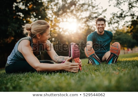 Smiling woman in park exercising Stock photo © IS2