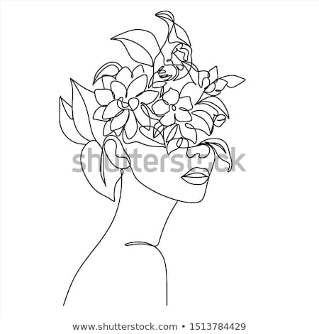 Stock photo: Young female face with flowers