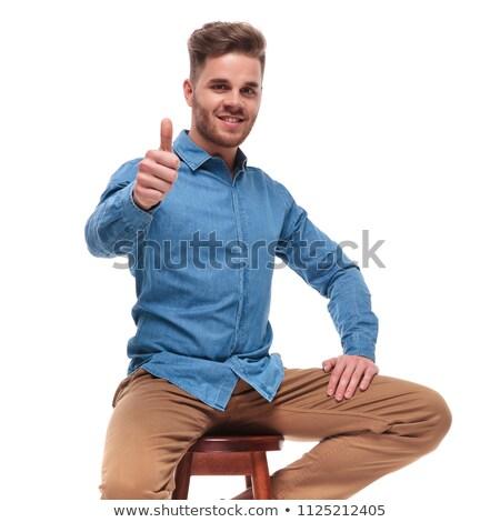 Boldog férfi ül zsámoly készít ok Stock fotó © feedough