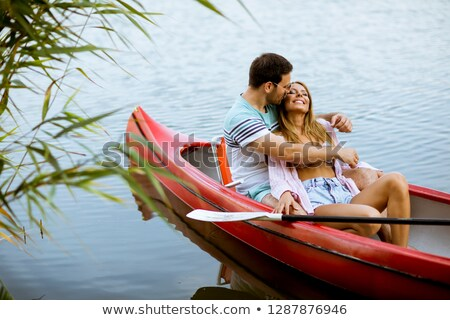 man, woman in rowing boat on lake Stock photo © IS2