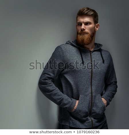 Foto d'archivio: Serious Portrait Of Adult Man With Hoodie