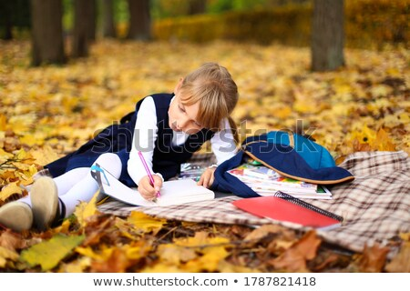girl with pigtails lying on leaves Stock photo © IS2