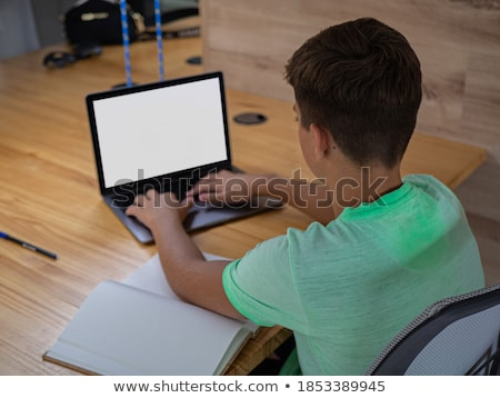 teenage boy doing homework stock photo © is2