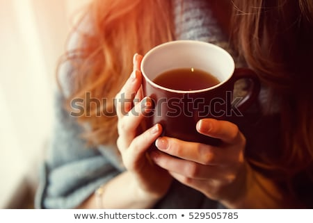 woman is drinking tea in the morning Stock photo © Pilgrimego