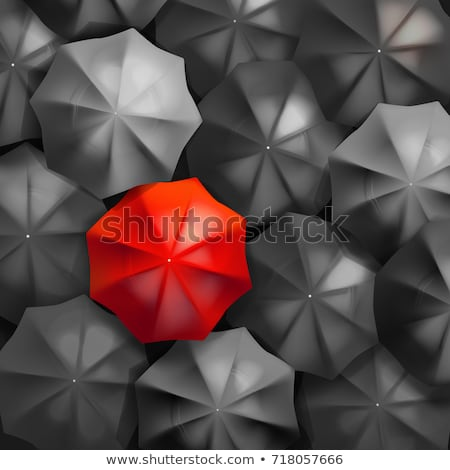 top view of unique red umbrella standing out from the blue crowd stock photo © iserg