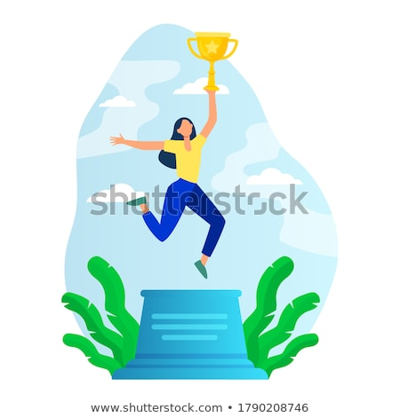 woman jumping holding trophy stock photo © is2