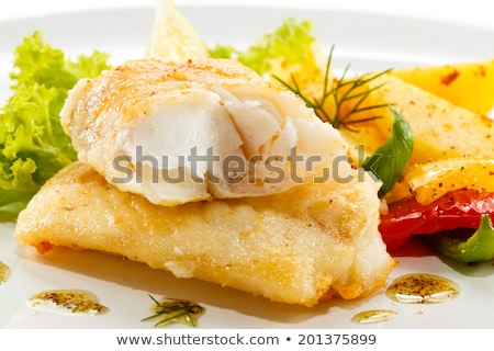 fried fish fillet with baked potatoes stock photo © melnyk