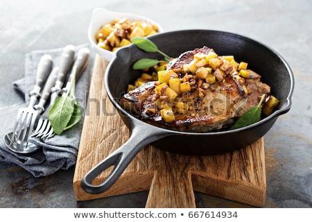 Roasted pork steak with caramelized apples Stock photo © Melnyk