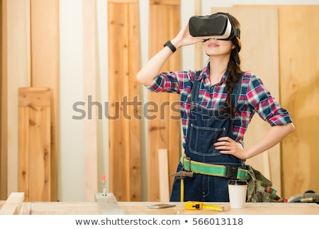 woman using virtual reality goggles in workshop stock photo © dash