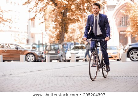 Gray Suit Businessman ride on city bicycle Stock photo © toyotoyo