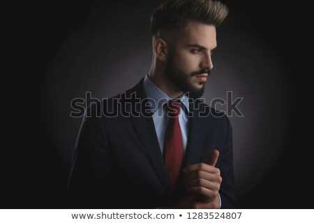 attractive businessman in navy suit holding palms together Stock photo © feedough